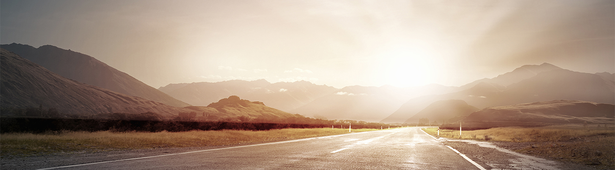 header image of sunrise on road